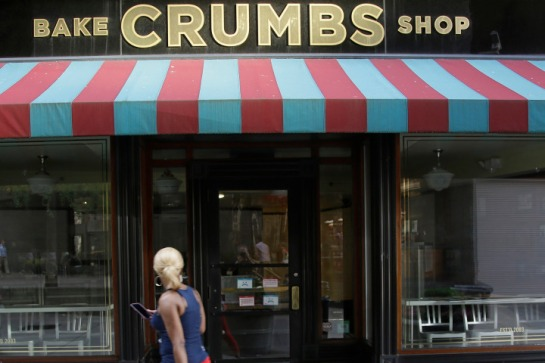 A Crumbs cupcake shop sits empty on Federal Street Tuesday, July 8, 2014, in Boston. Crumbs says it is shuttering all of its stores a week after the struggling cupcake shop operator was delisted from the Nasdaq. (AP Photo Stephan Savoia)